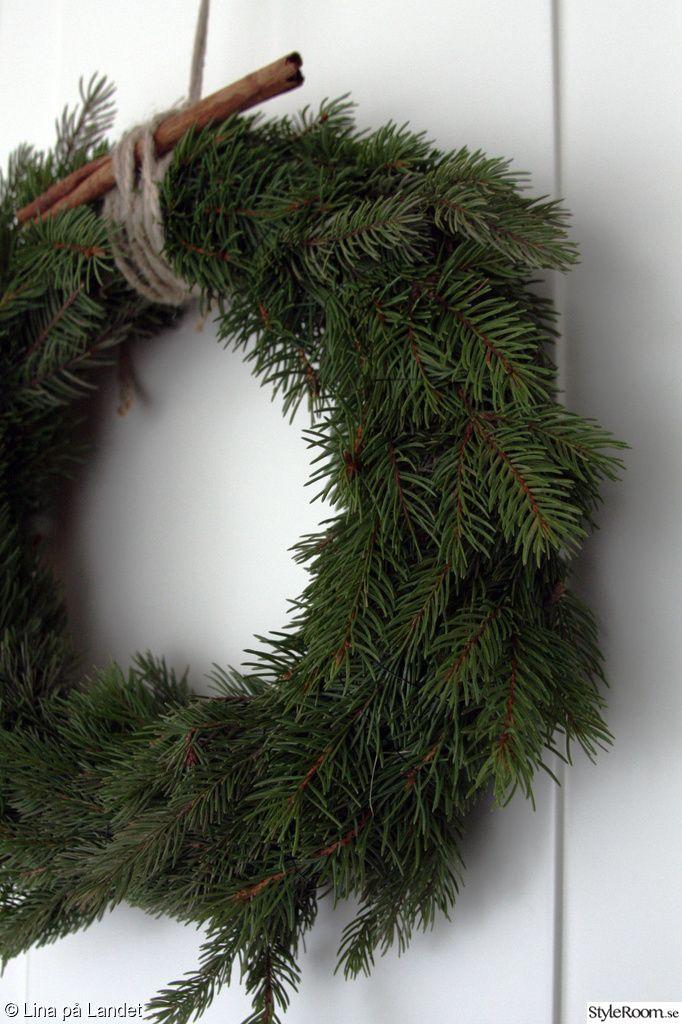 julkrans av granris,dörrkrans
