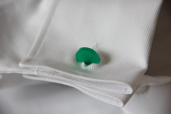 Curved green cufflinks