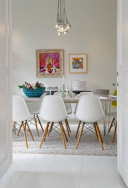 White dining room with colour