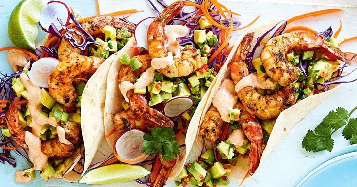 For a quick 30-minute meal, load fresh tortilla wraps with Mexican-spiced prawns, cabbage, radish, lime-avocado salsa and smoky mayo.