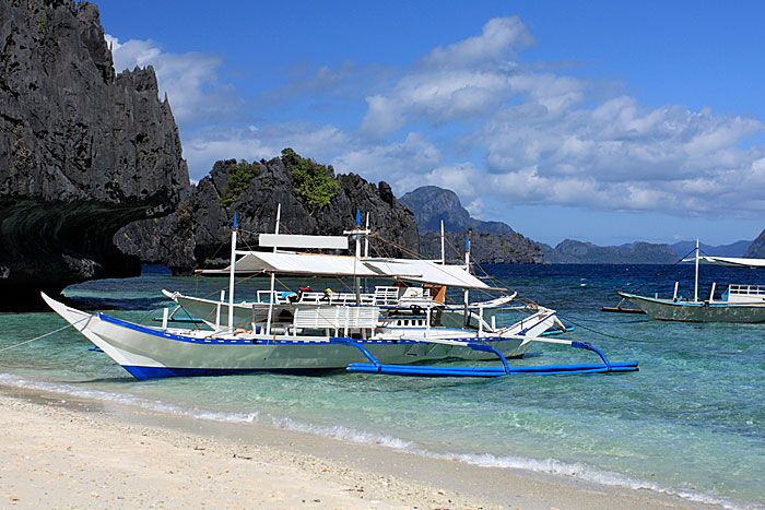 photos of philippines | couple of bancas in the famous, luxury beach resort El Nido region ...