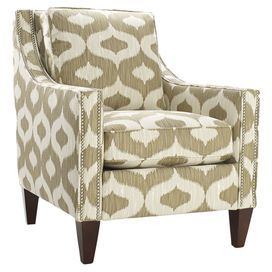 "Offer a retro-chic seat with this ogee-print accent chair. Subdued by a cream and taupe palette, this streamlined design features a loose pillow back and tapered feet. Made in the USA. Product: ChairConstruction Material: Wood and fabricColor: Cream and taupe Features: Ogee-inspired motifMade in the USANailhead trim Dimensions: 36"" H x 35.5"" W x 29.5"" D"