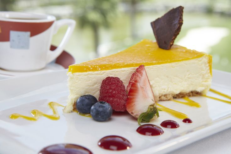 Mango Cheesecake - served with raspberry coulis