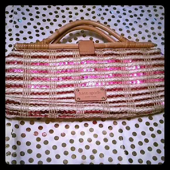 Kate Spade woven sequin clutch Very rare Katr Spade sequin woven clutch. This little shiny bag is,adorable. Sparkly summer fun! This bag has wooden handles and a wooden clasp forclosure. Inside zipper pockets and shiny fuchsia sequins woven with the beige straw outside. Used a few times for weddings and has a very small makeup blemish inside near the inner pocket. kate spade Bags
