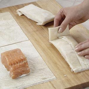 Salmon in Phyllo Find phyllo dough near the other puff pastries in the freezer section of your local grocery store. Wrap it around salmon for a crispy pastry seafood bundle.
