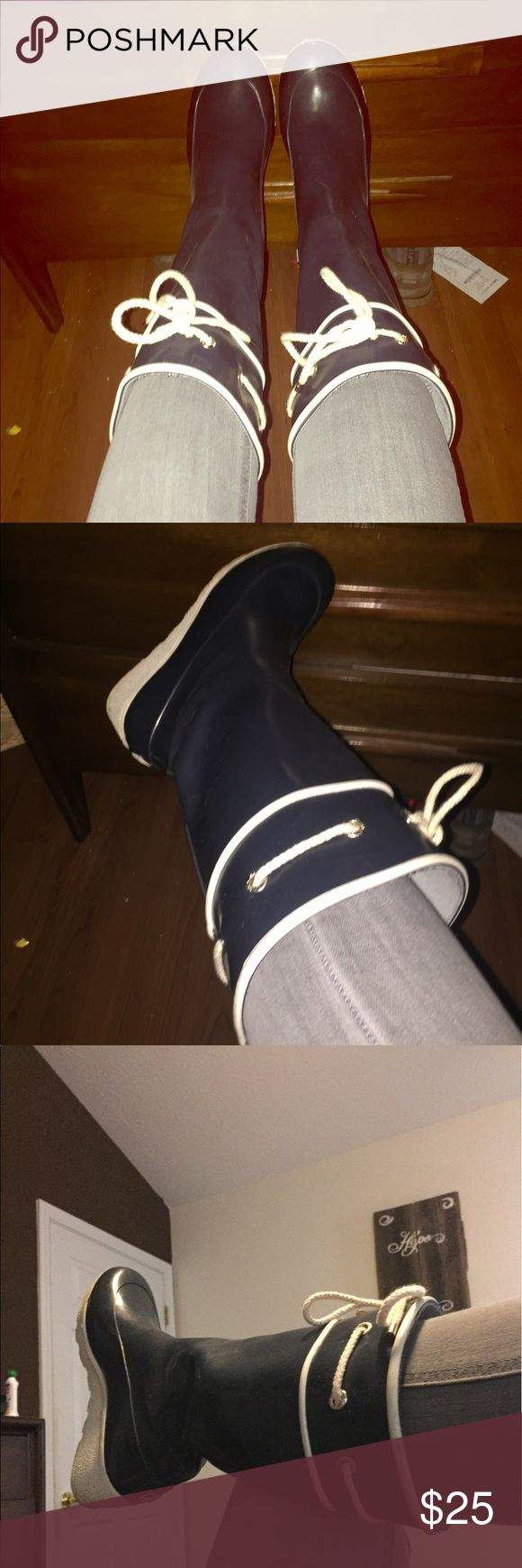 Navy blue Nautical Sperry wedge heel rain ☔️ boots These are adorable yet practical Navy Blue Sperry rain boots!  They have cream lace detailing around the top for looks and a cute, modest wedge heel.  Don't be afraid to wear these cuties on a rainy day and still be fashionable!  The inside is great and clean!  Comfy and fuzzy lined but not thick at all.  Very comfy for all day wear.  True to size 9.  A scrape or scuff here or there but years of life left.  High grade materials!  Will be…