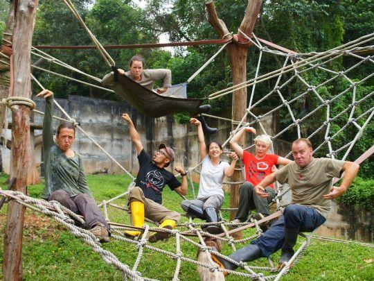 Volunteers imitating the animals http://www.oysterworldwide.com/gap-year/zoo-assistant-internship-in-malaysia/