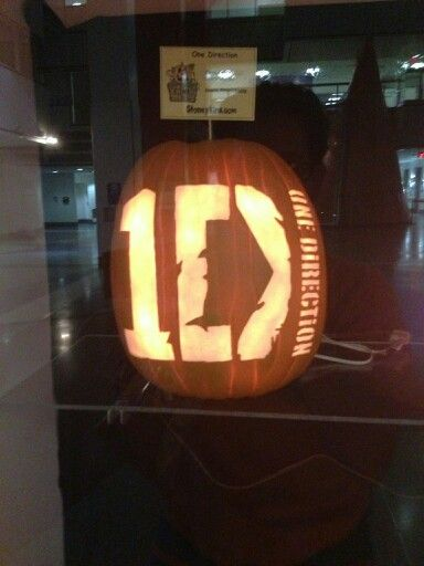 One Direction carved pumpkin for my tween. I so want to do this