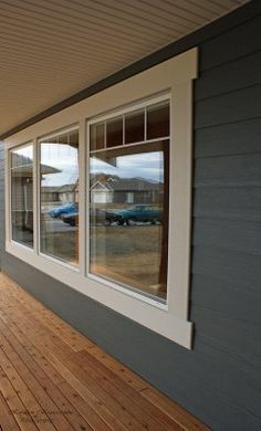 White Exterior Window Trim  - we can do this with wood and cover it with cemcrete before painting it white!!!