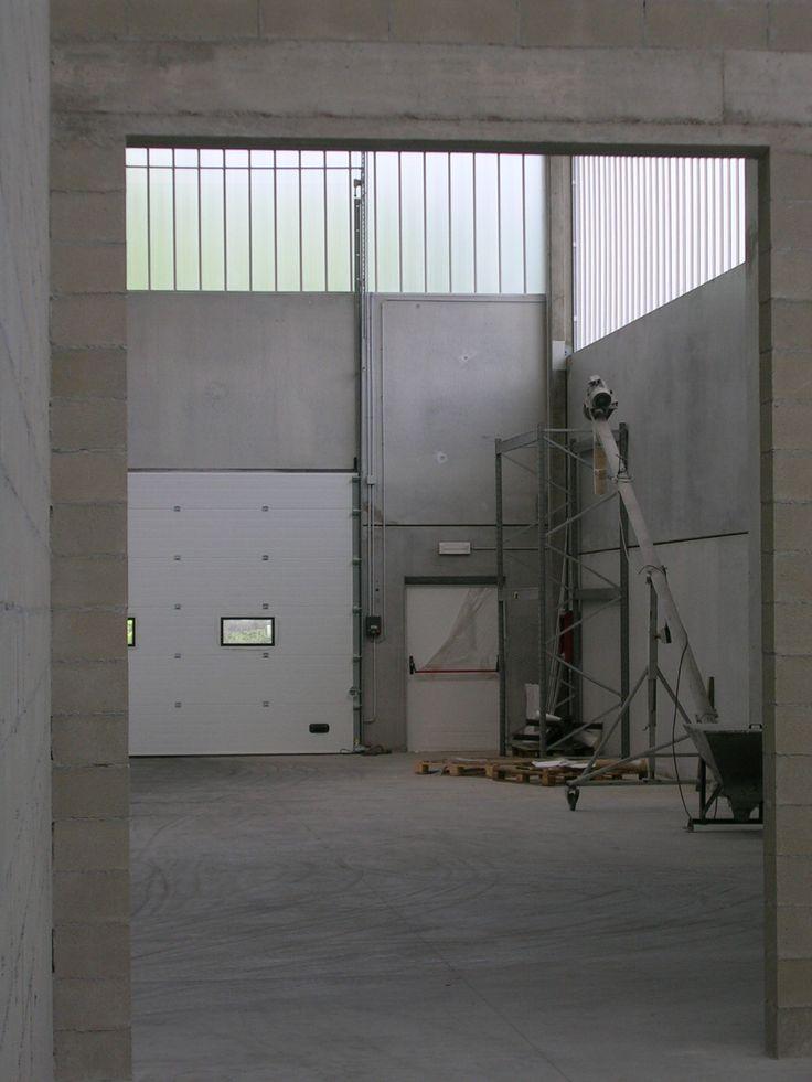 Portone sezionale con porta di sicurezza laterale