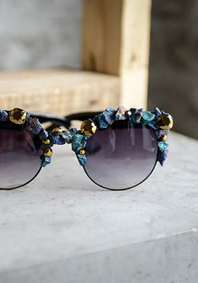 The sun has NOTHING on these gorgeous peacock inspired rock and gem encrusted shades by GASOLINE GLAMOUR.  www.shopculture.ca