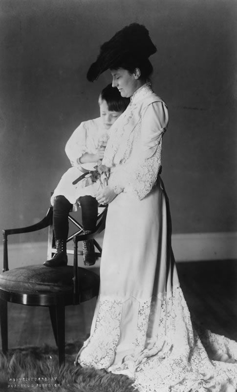 """Photo of Edith Roosevelt with son, Quentin, from the """"First Ladies: Political Role and Public Image"""" exhibition. Edith Roosevelt did not share her husband's thirst for publicity, but knowing she must deal with the press, she injected both decorum and whimsy into coverage of her rambunctious family. She screened photographers, oversaw the selection of photographs, chose the magazines in which they would appear, and selected authors to write the stories. Courtesy Library of Congress…"""