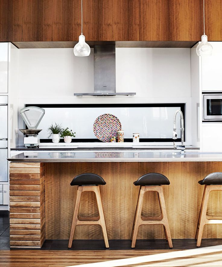 **Timber touches.** Timber is the hero material in the on-trend natural movement. It adds a warm and rustic touch (especially if it's reclaimed) yet still manages to feel 100 percent contemporary. Try timber cabinetry or a timber bench and stools. *Photo: Sharyn Cairns/bauersyndication.com.au*