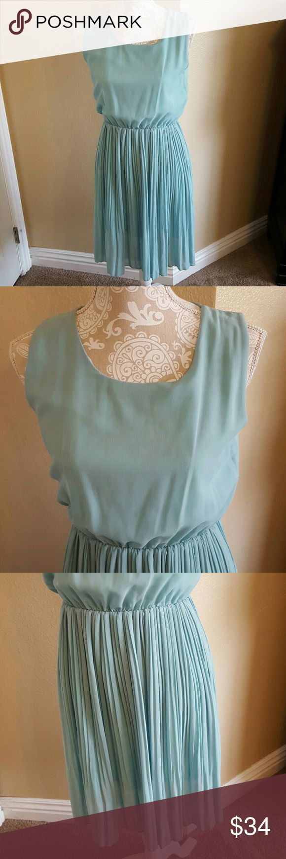 NWT Beautiful Mint Chifon Dress Size M NWT Beautiful Mint Chifon Dress Size M Perfect dress for so many occasions in the color of the moment mint! Cinch waist does have stetch and it is fully lined. Would look cute with a belt as well! Reposh never wore. Boutique Dresses Asymmetrical