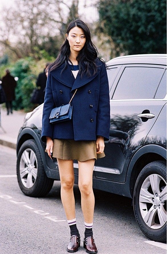 Studded loafers and a flared skirt detail a simple outfit. //  #StreetStyle