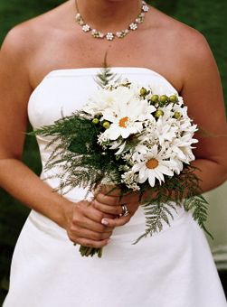 Daisy and Stephanotis Wedding Bouquet . The bride held a bouquet of daisies, stephanotis, hypericum berries and plumosa by Country Flowers Antiques and Gifts.