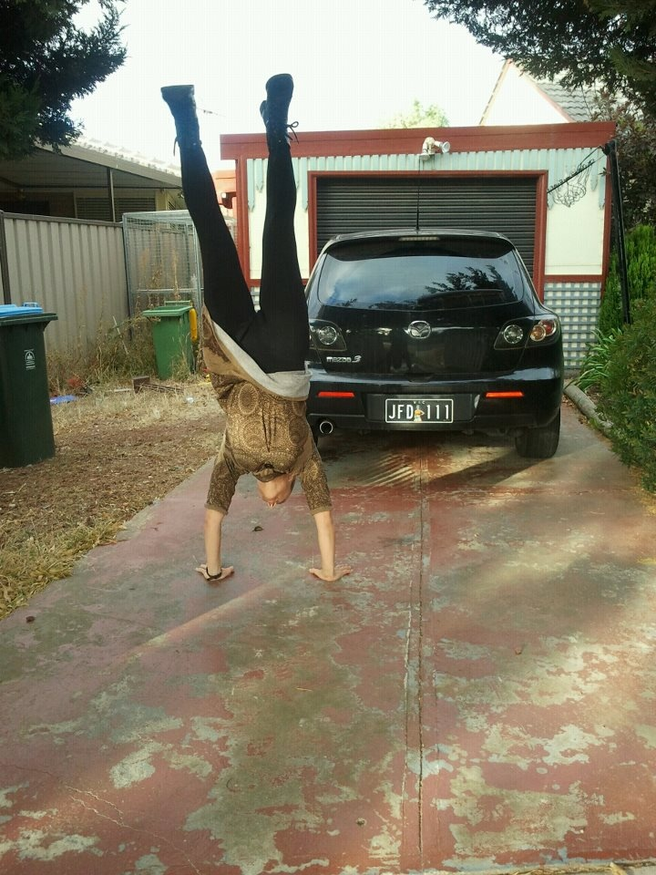 Feb 20: On my way to school drop off and work, showing off my FAB Wonder Woman number plates...and inappropriate clothig for handstands.