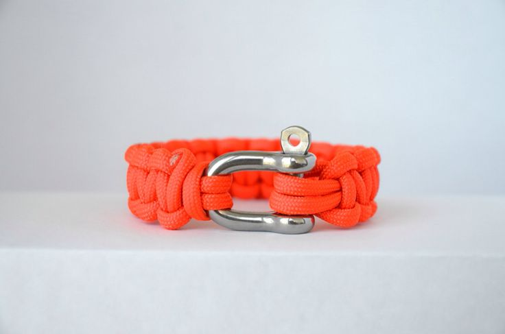 Neon Orange // Paracord Survival Bracelet | This colour radiates warmth and happiness, and thirst for action. Individuals inspired by this colour have an enthusiasm for life and adventure and are always on the go. Since Tangerine was declared the colour of the year in 2012, the colour has been seen in ready-to-wear fashion since that spring season. One of the most vibrant colours and is superior in terms of visibility. For an individual seeking an eye catching statement piece.  #Paracord