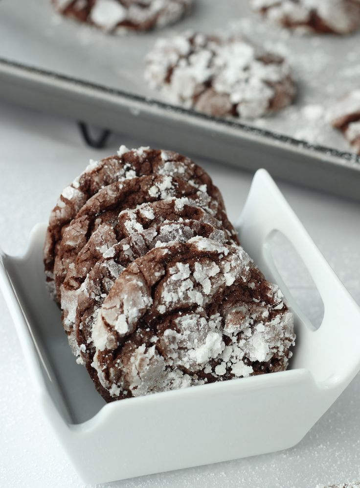 Chocolate Crackle Cookies -  1 box cake mix [Devils Food or other amazing chocolate mix]  2 eggs  ½ cup oil  Powdered sugar     Pre-heat oven to 350°  Mix first three ingredients together until few lumps remain. Batter will continue to thicken as it sits. Not that it matters.  Drop tablespoon sized balls into powdered sugar and generously coat.  I mean generously. I've done this step wrong. It resulted in plain old chocolate cookies. Seriously not okay. Cake it on