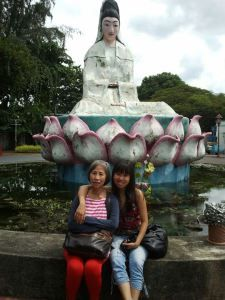 Pic with my mom in front of Guan Yin Statue - Haw Par Villa in #Singapore - #TravelTips #TravelPics