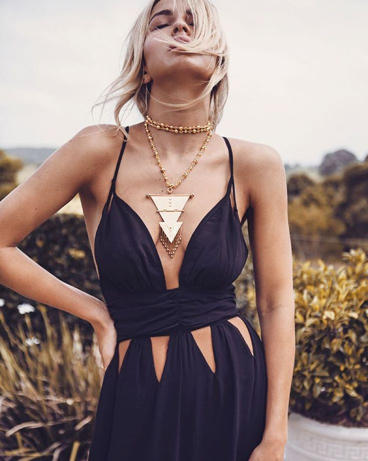 Black cut out dress with gold chunky geometric necklace