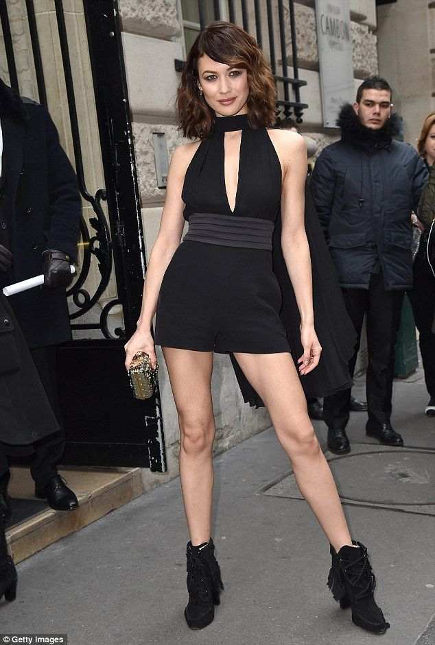 All eyes on her: Olga Kurylenko, 37, made a sexy arrival in a tiny playsuit at the Elie Saab Spring/Summer 2017 show for Paris Haute Couture Fashion Week on Wednesday