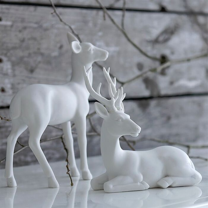 I would love these on my dining room table for Christmas. Snowy deer
