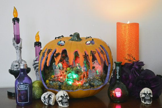 Beware! The graveyard is alive with monsters! -Durable Craft pumpkin -Lemax figures -Stickers on exterior -LED, battery operated lights -Unique, balanced design -Item measures 11 X 9.5 X 9.5 -Use shipping box for storage or a tote ***Get a $10 coupon to use in our shop or at craft fairs when you sign up for our email newsletter. Copy and paste this link: http://eepurl.com/1VE0r We hate spam, we wont spam you either! You will be emailed a coupon code within a few minutes after you confirm…