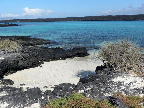 White sandy beach on Sombrero Chino (Chinese Hat) island