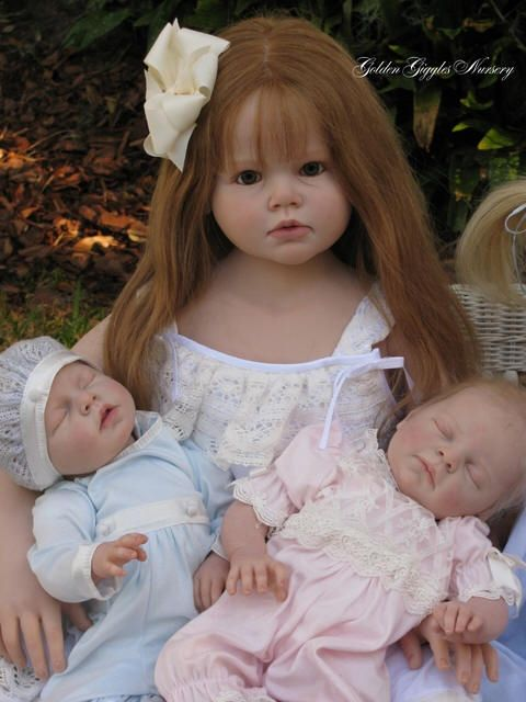 Big sister....dolls I BET PEOPLE WILL THINK THEY ARE REAL BUT AFTER THAT MONKEY I SAY DOLLS BEAUTIFUL ONES TOO