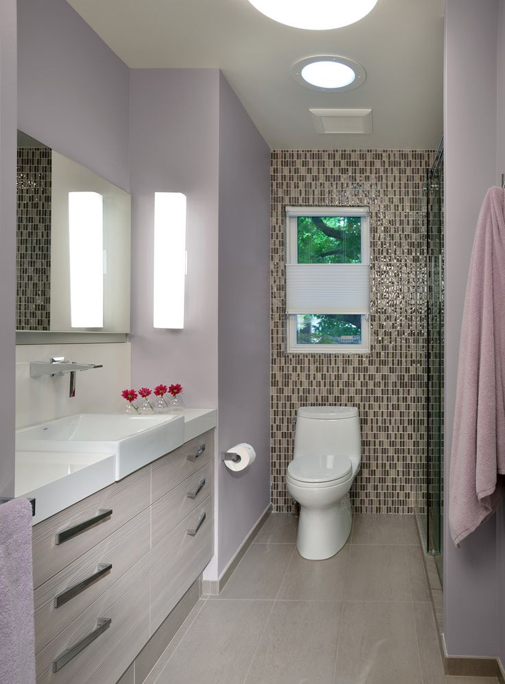 Photo Album Website A sleek inset vanity helps this small bathroom feel larger The stunning tile accent wall also visually expands the space creating the illusion of depth
