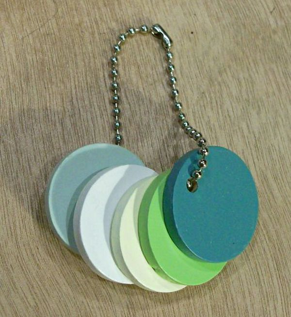 If you're in the process of decorating your space, this may be the single most helpful tool you could own: a paint chip keychain custom-made from your own color palette!  It's a simple DIY project that will make shopping for furniture, fabric, or accessories that much easier.