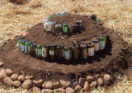 Herb spiral made from beer bottles. Recycle in your garden. #livingecology #permacultureinternship
