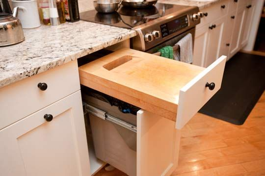 Generally not a fan of pull out cutting boards but the garbage/compost drawer beneath is genius.