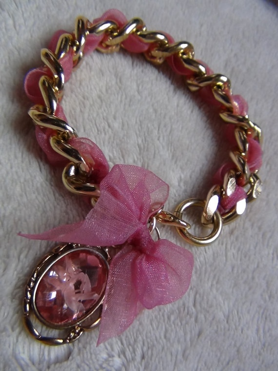 Adorable pink bow bracelet. I would want a different color and silver instead of gold