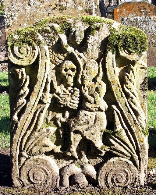 Auld Alloway Kirk Gravestone, showing a skeleton snuffing out a candle (representing life being 'snuffed out')