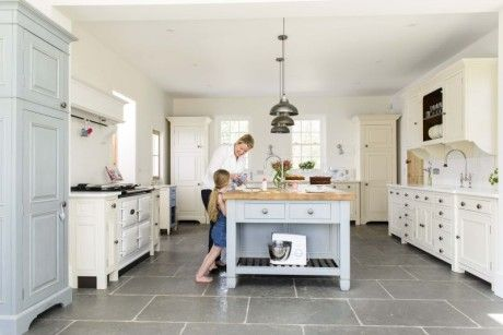 The Worn Grey Limestone in Miranda Gore Browne's Kitchen. A stunning floor perfectly complemented by the painted colours of the kitchen units.
