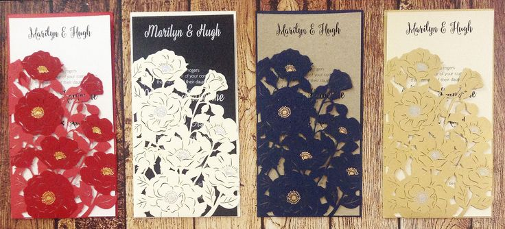 Stunning laser cut poppies invitation sleeves with delicate foiled accents