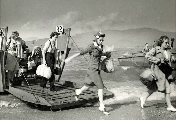 """Here's a Normandy Beach landing photo they don't show you in textbooks. Brave women of the Red Cross arriving in 1944 to help the injured troops. (Borrowed from """"Do Something"""" Facebook posting.)"""