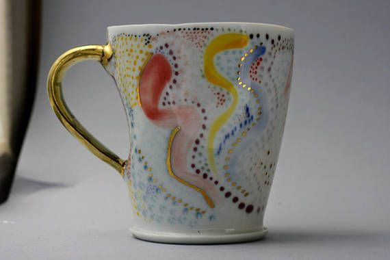 Porcelain wheel thrown-hand painted mug aprox 810oz. With
