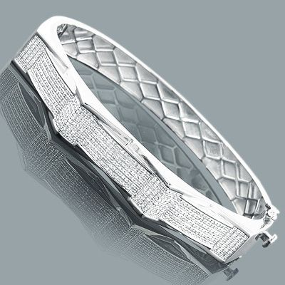 This Mens Diamond Bangle Bracelet in sterling silver weighs approximately 38 grams and showcases 1.1 carats of genuine diamonds. Featuring a unique design and a luxurious rhodium plating for extra shine, this men's diamond bracelet is a great alternative to gold jewelry.