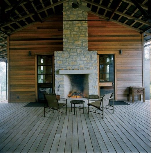 This fireplace is in the breezeway of this dogtrot floor plan. With some careful design, this space could be enclosed with glass doors for use in the cooler months and opened completely for warmer months.