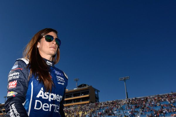 Danica Patrick Photos - Danica Patrick, driver of the #10 Aspen Dental Ford, walks on the grid prior to the Monster Energy NASCAR Cup Series Championship Ford EcoBoost 400 at Homestead-Miami Speedway on November 19, 2017 in Homestead, Florida. - Monster Energy NASCAR Cup Series Championship Ford EcoBoost 400