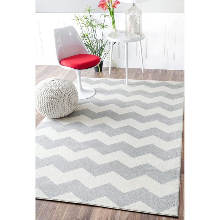 Soft and plush, the pile on this contemporary area rug is made from 100% polypropylene to prevent shedding, and will tie together any fashionable space.  Add a sense of modern flair to any living room with this attractive rug.