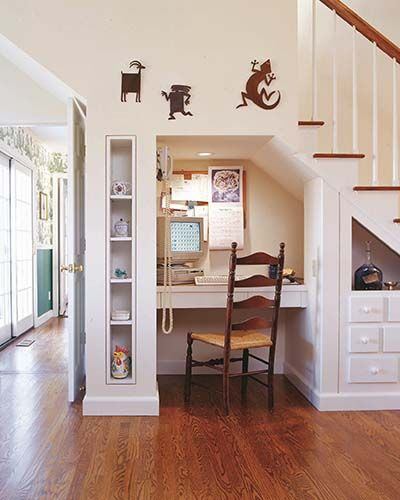 Pocket offices such as this one are extremely popular with homebuyers. This storage and display space uses a previously unused area under the stairs. The project fits beautifully into this home because its style and materials echo cabinets, trim, paint colors and clean lines found throughout the house.