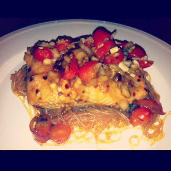 Honey and soy glazed organic salmon with glass noodles, siracha soy dressing, with roasted tomatoes, onions and garlic.
