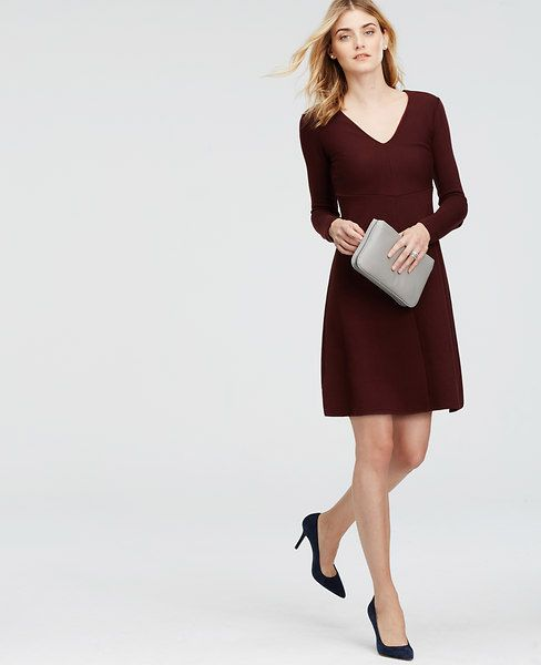 "Flawlessly fitted for work and beyond, our luxe wool jersey dress flaunts a marvelously flattering flare. V-neck. Long sleeves. Hidden back zipper with hook-and-eye closure. Lined bodice. 20 1/2"" from natural waist."