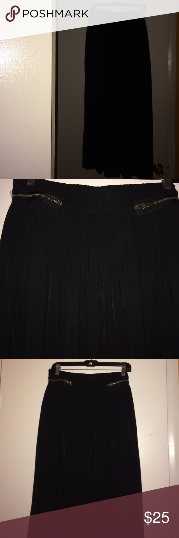 Long Pleated skirt Long pleated sheer skirt. It has a second layer to it. I love the exposed zippers on the front it has a comfy waist band. New York & Company Skirts Maxi