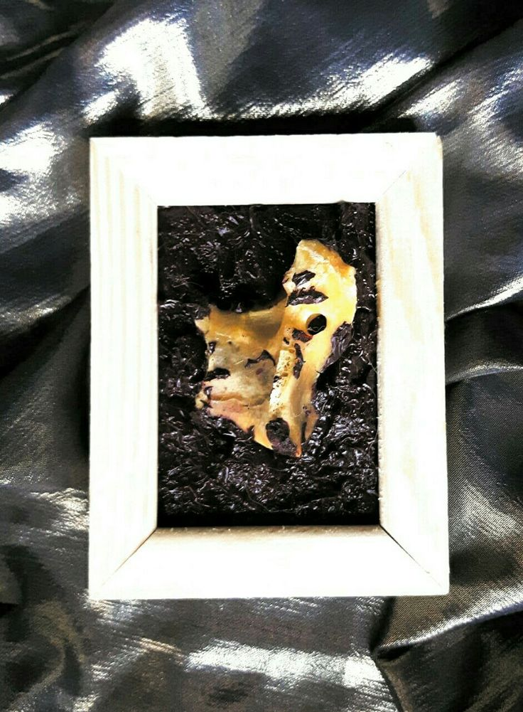 """Vertebra"", 9 x 6 cm, bone and oil on canvas."