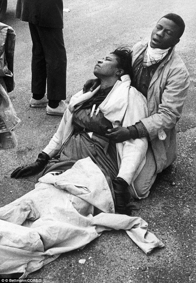 Seen around the world: Amelia Boynton Robinson is held after being violently beaten by Ala...